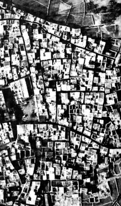 Figure 2: Pyrgi, village on the island of Chios, Aegean sea, Greece, whose origins date back to the mid-14th century. The air photo is of the northern half of the village, taken in 1934. Courtesy Ministry of Public Works, Aerial photos Department, Greece.