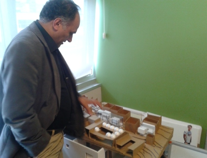 The Head of the Department of Architecture, Özyeğin University, Professor Dr. Murat Şahin,  showing a model in his office.